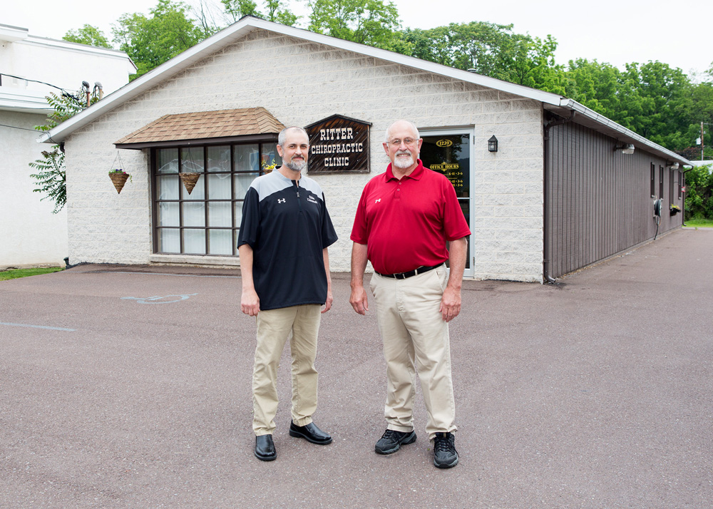 doctors matt ritter and earl ritter in front of their clinic